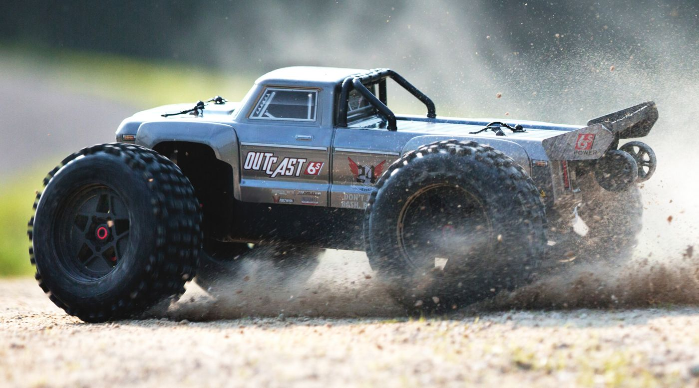 Arrma ARA106042T1 - 1/8 OUTCAST 6S BLX 4WD Brushless Stunt Truck with Spektrum RTR, Silver